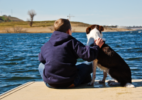 My brother and my wet dog at the lake on a colder winter day.